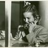 American Telephone & Telegraph Exhibit - Close-up of girl on phone