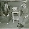 American Telephone & Telegraph Exhibit - Adolph Menjou and his wife listening in on phone conversation