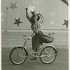 Amusements - American Jubilee - Scenes - Bicycle Number - Tina Regat on bicycle