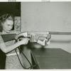 Amusements - Games and Rides - Woman shooting tommy gun