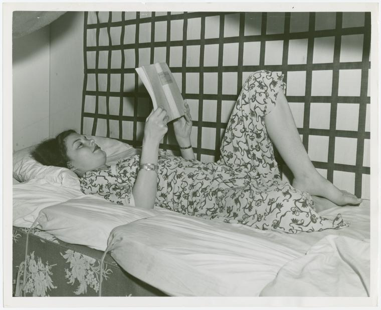 Amusements - Games and Rides - De-Bunk-Her - Girl reading in bed