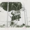 Amusements - Games and Rides - Parachute Jump - Man and woman on ride