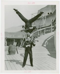 Amusements - Midway Activities - Two acrobats playing instruments