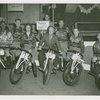 "Amusements - Midway Activities - Barkers - Harold ""Wandering"" Smith with men and women on bikes"