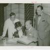 Amusements - Performers and Personalities - Bergen, Edgar - Signing guestbook with Charlie McCarthy, Fiorello LaGuardia and Grover Whalen