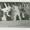 Amusements - Performers and Personalities - Musicians - Louis Prima playing trumpet for dancers