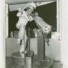 Amusements - Performers and Personalities - Robinson, Bill - In costume, peering through telescope