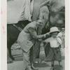 Amusements - Shows and Attractions - Frank Buck's Jungleland - Elephants - Frank Buck and boy