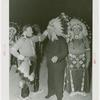 Amusements - Shows and Attractions - Wild West - Indian man putting headdress on Grover Whalen