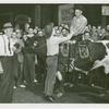 Amusements - Shows and Attractions - Wild West - Man on bull shaking hands with man on ground