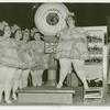 Amusements - Villages - Old New York - Showgirl being weighed