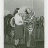 Arizona Participation - Cowboy showing girl branding iron