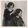 Mariana combing June's hair (Mariana Romo-Carmona and June Chan). NYC.