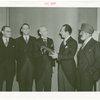 Australia Participation - L.R. MacGregor (Commissioner) presents copy of Australian constitution for exhibit