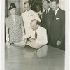 Australia Participation - L.R. MacGregor (Commissioner) signing guest register at Perylon Hall