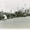 Automobiles - Ye Goode Olde Days - Men cranking cars at start of race