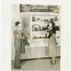 Bakelite Plastics Exhibit - Man and woman at automotive display