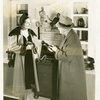 Bakelite Plastics Exhibit - Man and woman at business appliances display