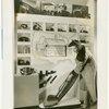 Bakelite Plastics Exhibit - Woman at display on household appliances