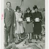 Ballantine - Carl W. Badenhausen with girls putting money in cornerstone