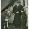 Borden - Jeffers, Henry (Inventor of Rotolactor, President of Walker-Gordon) - With granddaughter and cow