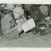 Boy Scouts - Boy writing on map