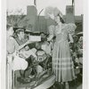 Children - Crippled Children's Outing - Boy receiving lunch from Old New York actress
