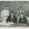 Christian Science - Grover Whalen signing contract with Christian Scientists executive committee chairman