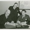 Christian Science - Harvey Gibson signing contract with Christian Scientists executive committee chairman