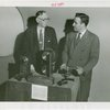 Communications - Exhibits - Men demonstrating film apparatus