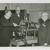 Consolidated Edison - Floyd L. Carlisle pulls switch on Edison's Dynamo, Oscar Fogg and Ralph Tapscott look on
