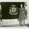 Contests - Woman posed in front of flag