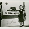 Contests - Woman posed in front of California flag