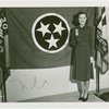 Contests - Woman posed in front of Tennessee flag