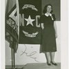 Contests - Woman posed in front of North Carolina flag