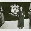 Contests - Woman posed in front of Connecticut flag