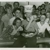 Contests - Pie-eating champion with other contestants