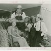 Continental Baking Co. - Harvest Queen receiving crown from James Montgomery Flagg while Grover Whalen and M. Lee Marshall (President, Continental Baking Co.) look on