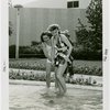 Fashion, World of - Models - Bathing Suits - Models wading in pool