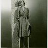 Fashion, World of - Models - Dresses - Model leaning against pole