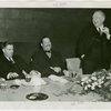Federal (United States Government) Exhibit - Grover Whalen, Sam D. McReynolds and Henry A. Wallace (U.S. Secretary of Agriculture) at luncheon