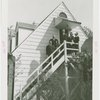 Federal Housing Administration - Houses - Group with Grover Whalen on stairs of house