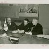 Finland Participation - Harry Roneholm (Finland Commissioner), K.F. Altio and William Standley sign contract