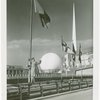 Flags - Woman under flag with Trylon and Perisphere in background