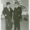 Flags - Two men in front of American flag