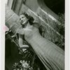 Florida Participation - Woman in evening dress leaning on palm tree