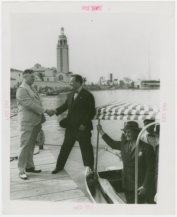 Florida Participation - Brown, Earl W. - Shaking hands with Grover Whalen outside pavilion