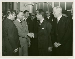 Ford - Ford, Edsel - Shaking Douglas S. Cole's hand upon completion of 28 millionth Ford car