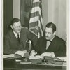 German Consul General, Johannes Borchers, signing contract with Grover Whalen