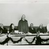 General Cigar Co. Participation - Man giving speech at luncheon with Grover Whalen, a white owl, and others